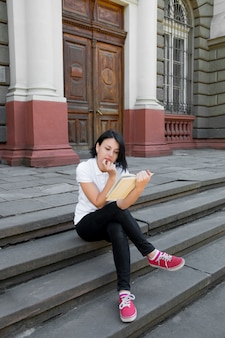 Woman is reading book.