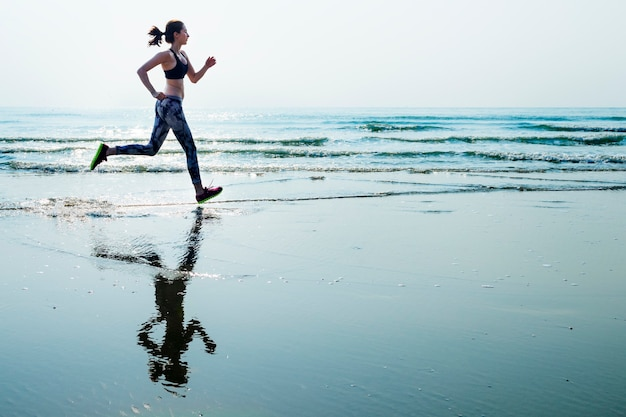 A woman is running at the beach