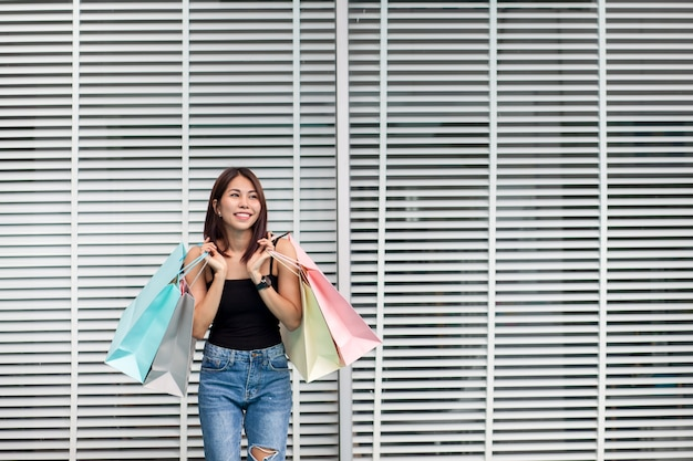 A woman is shopping happily