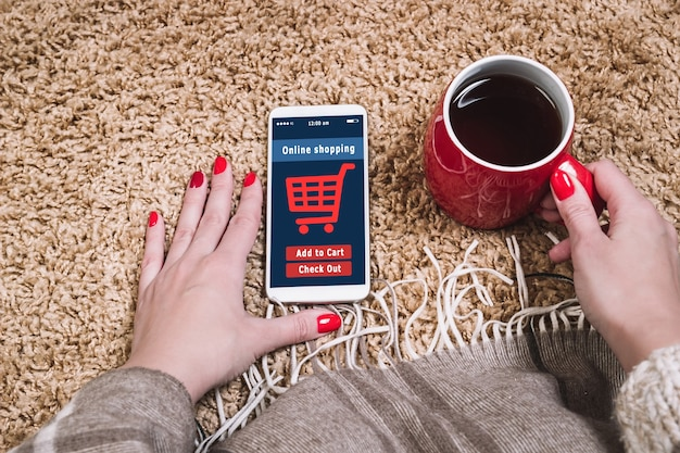 A woman is shopping at the online store, e-commerce.