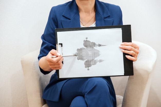 Woman is sitting and holding a picture. it is hand drawing.