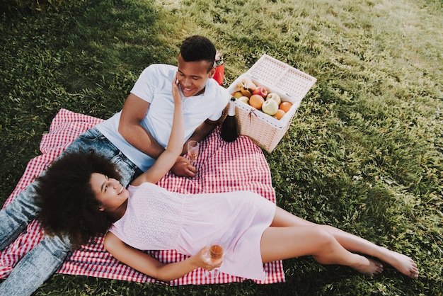 Woman is touching her boyfriend sunny summer day