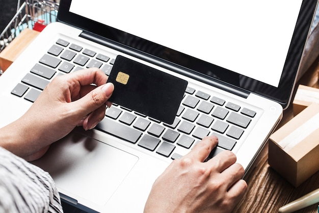 Woman is using a computer to shop online