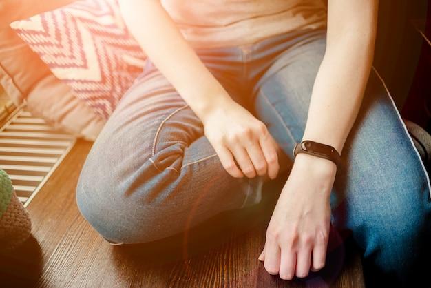 Woman is wearing a fitness bracelet.