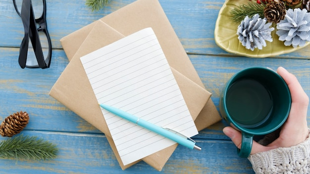 Woman is writing 2022 goals for new year resolutions plan