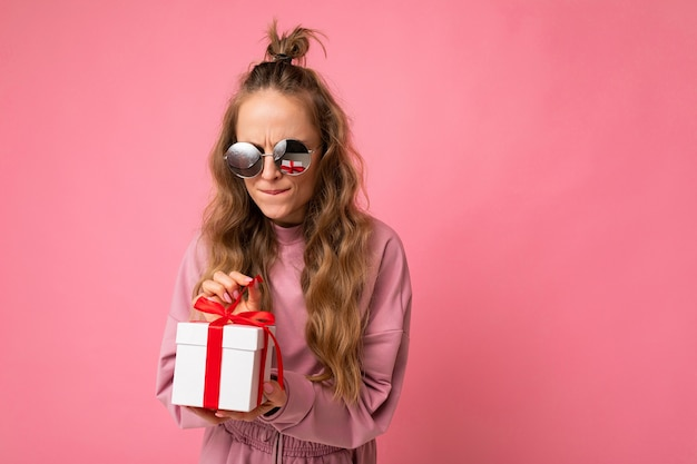 Woman isolated over pink background wall