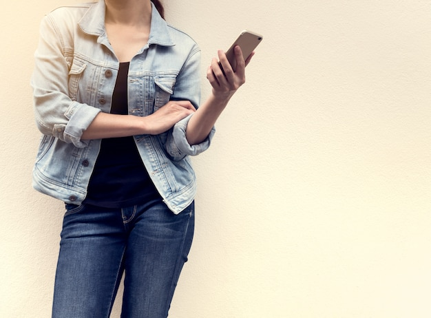 Woman in jeans fashion holding mobile phone
