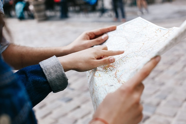 Woman in jeans jacket holds in her hands touristic map