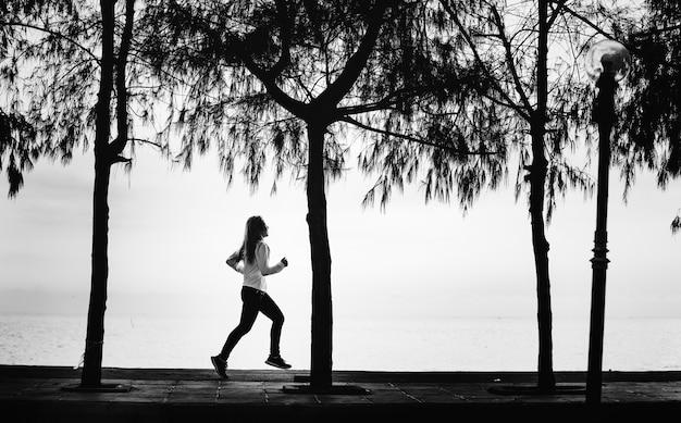 A woman jogging on a beach