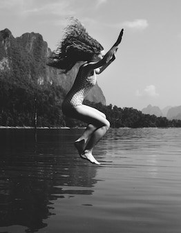 Woman jumping into the water