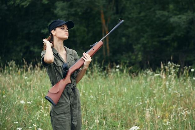 Woman in jumpsuit with handgun