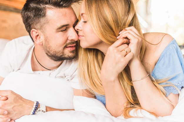 Woman kissing man tenderly on nose