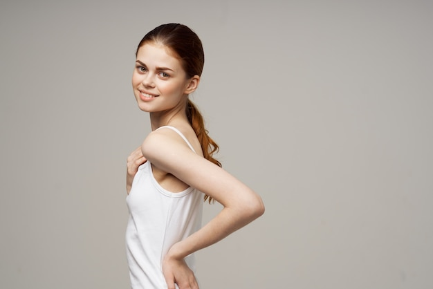 Woman kneads shoulders and back joint pain