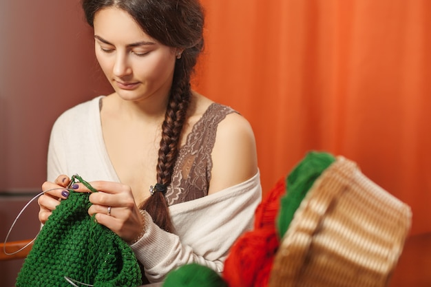 Woman knits woolen clothes