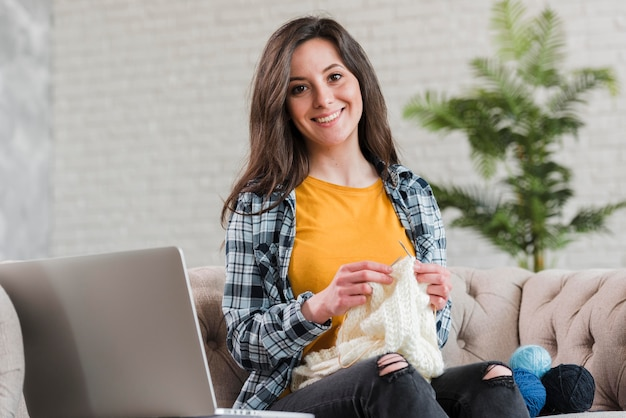 Woman knitting e-learning courses concept