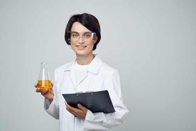 Woman laboratory assistant science chemical solution research technology