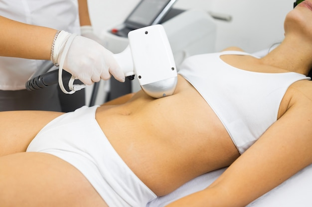 Woman on laser hair removal procedure