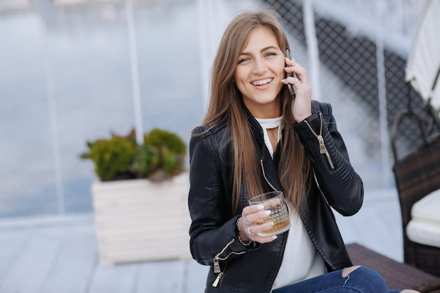 Woman laughing and talking on the phone