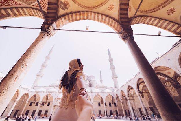 Woman leading man to follow her in istanbul famous sightseeing