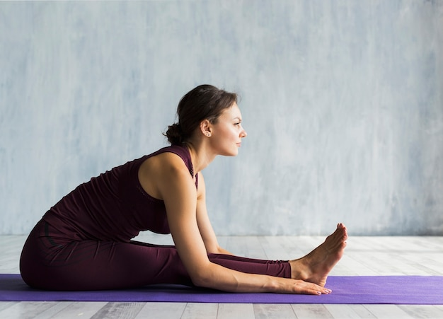 Woman leaning forward while practicing yoga
