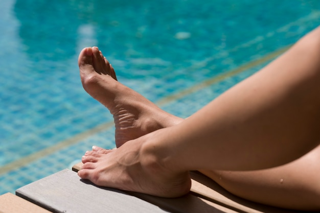 Woman leg at swimming pool
