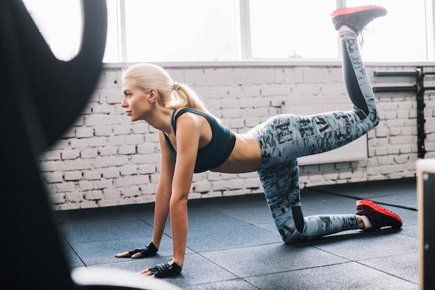 Woman in leggings lifting leg