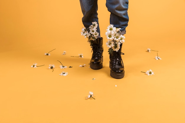 Woman legs wearing shoes with flowers inside