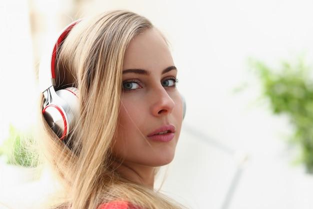 Woman lie on sofa listen music dream