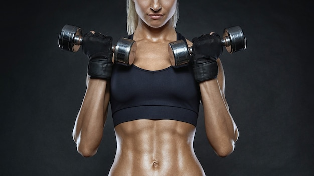 Woman lifting weights for body building training