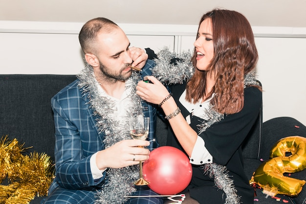 Woman lighting cigarette for man on party