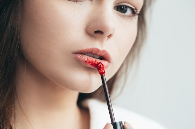Woman lipstick makeup portrait. beautiful female with red pink lips. studio shot.