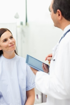 Woman listening to a doctor