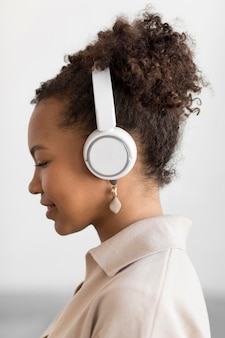 Woman listening to music close up