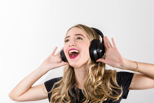 Woman listening music on headphones