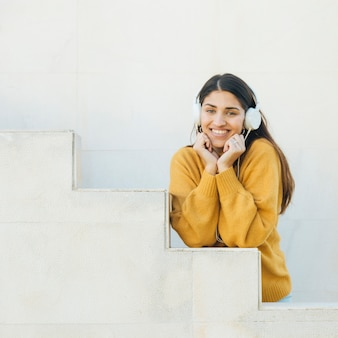 Woman listening music looking at camera