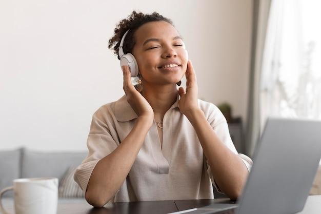 Woman listening to music medium shot