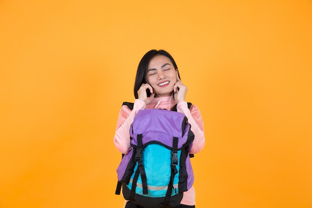 Woman listening to music and schoolbag