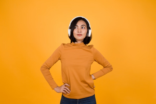 Woman listening to music with white headphones