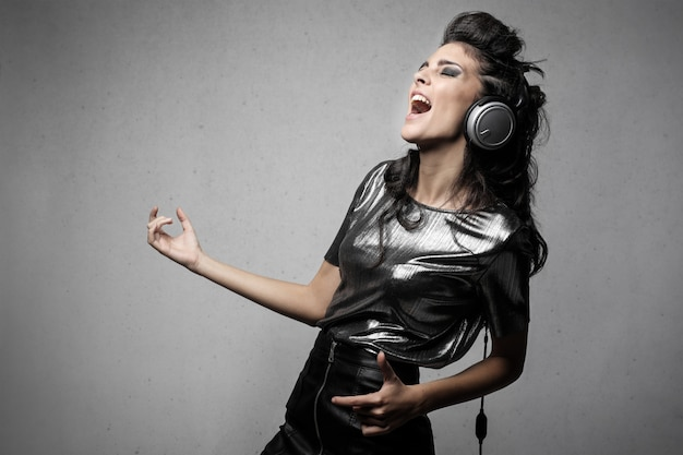 Woman listening to rock music