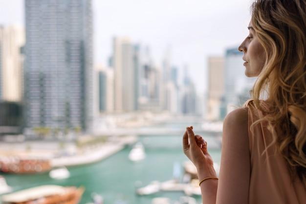 Woman in long dress at dubai marina