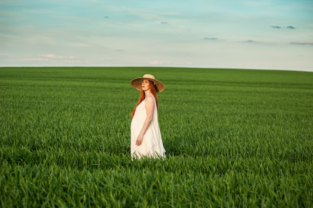 Woman in long white dress outdoor