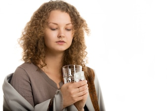 Woman looking a glass of water