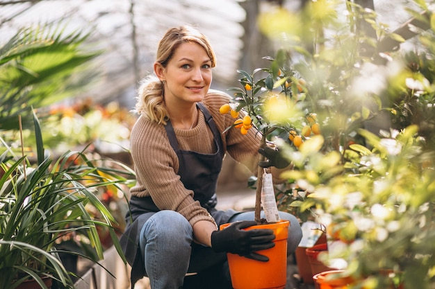 Woman looking after plants in a greenhouse
