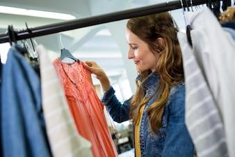 Woman looking at a dress