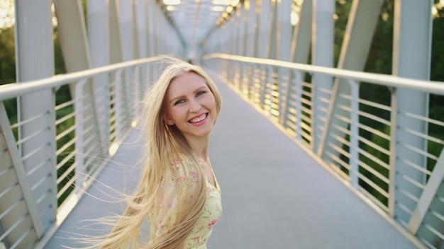 Woman looking back on bridge.