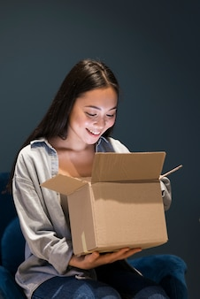 Woman looking in box after ordering online