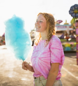 Woman looking at candy floss medium shot