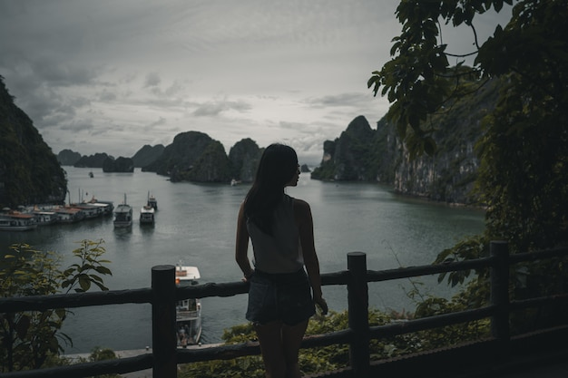 Woman looking over ha long bay vietnam