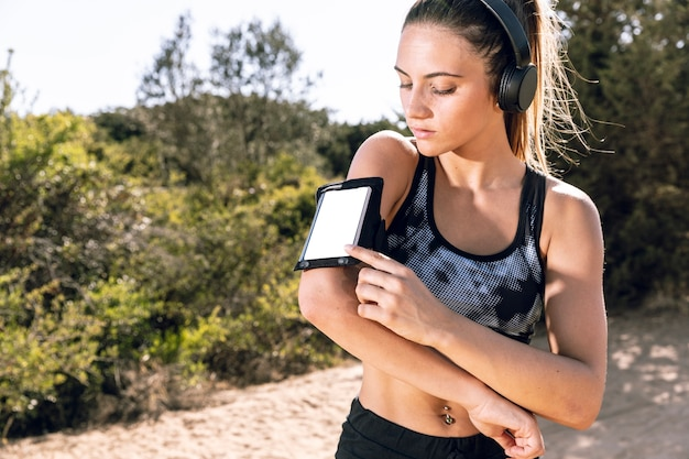 Woman looking at her phone armband