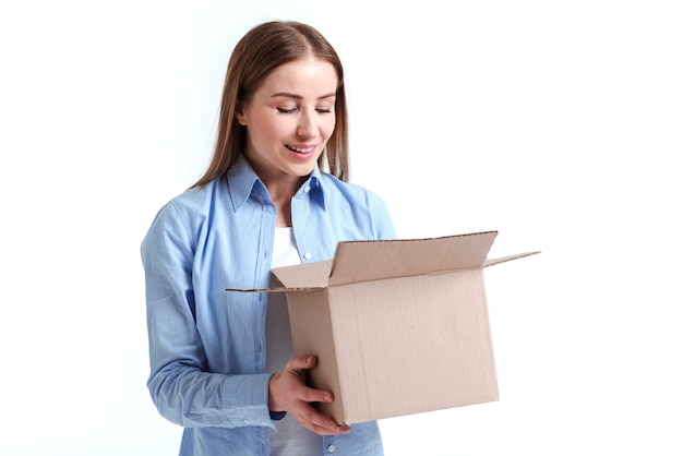 Woman looking into a box medium shot